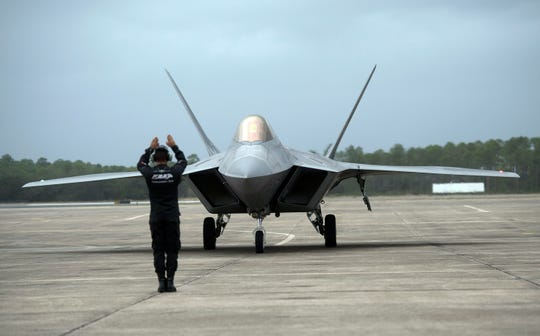 An Air Force F-22 Raptor arrives Thursday at Naval Air Station Pensacola.