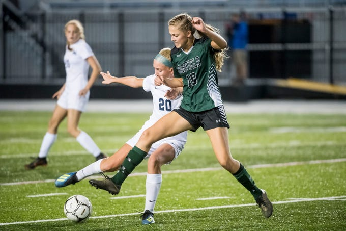Fairfield's Zoe Logue (10) fights for the ball with Camp Hill's Isabella Hoffer during the PIAA District III Class A championship game at Hershey Park Stadium on Wednesday, October 31, 2018. The Knights fell in overtime 1-0.