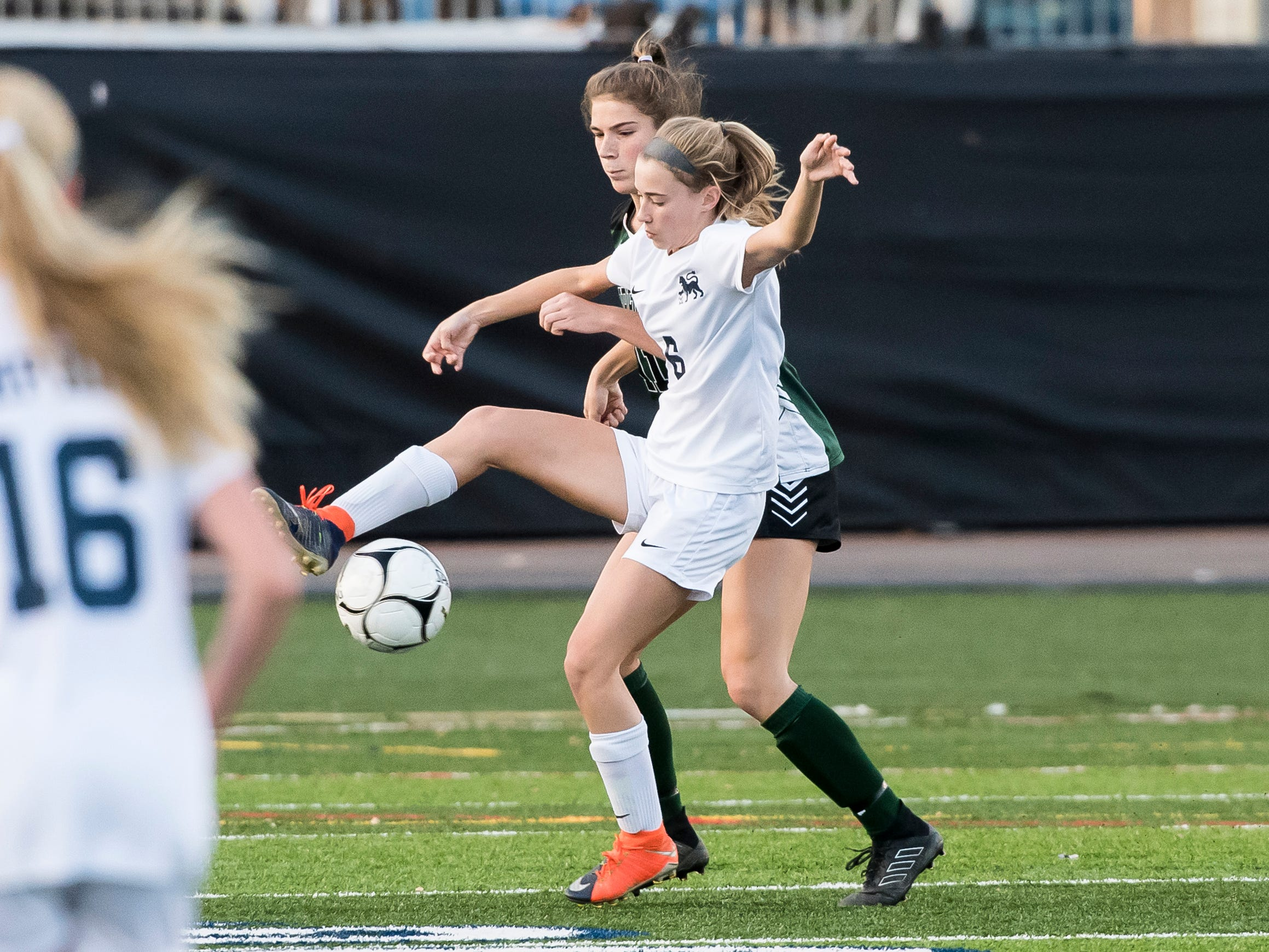 Camp Hill's Ava Brackett and Fairfield's Milly Heinbaugh fight for the ball during the PIAA District III Class A championship game against Fairfield at Hershey Park Stadium on Wednesday, October 31, 2018. The Knights fell 1-0 in overtime.
