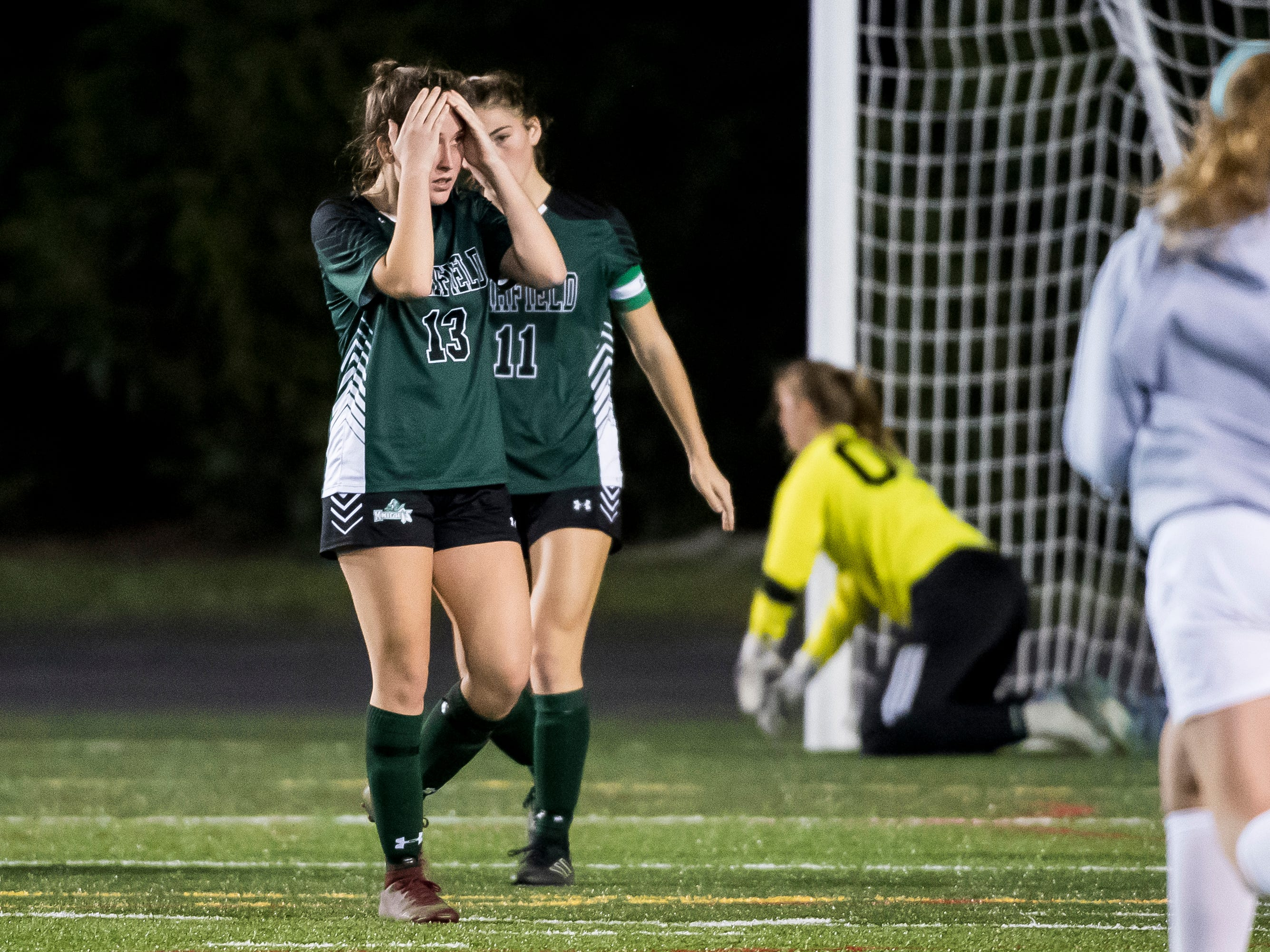 Fairfield's Honey Strosnider (13) reacts after the Knights fell 1-0 in overtime during the PIAA District III Class A championship game at Hershey Park Stadium on Wednesday, October 31, 2018.