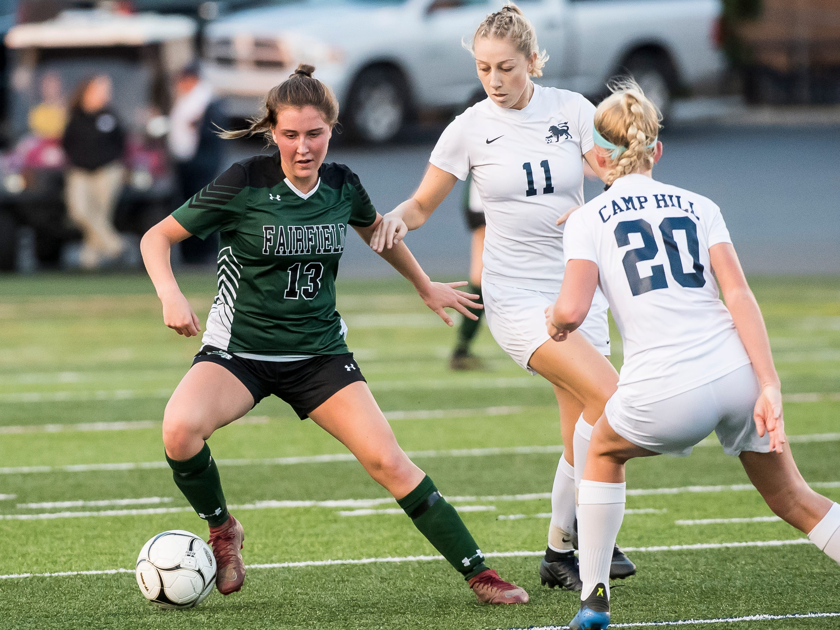 Fairfield's Honey Strosnider works around Camp Hill's Sheridan Reid (11) and Isabella Hoffer (20) during the PIAA District III Class A championship game at Hershey Park Stadium on Wednesday, October 31, 2018. The Knights fell in overtime 1-0.