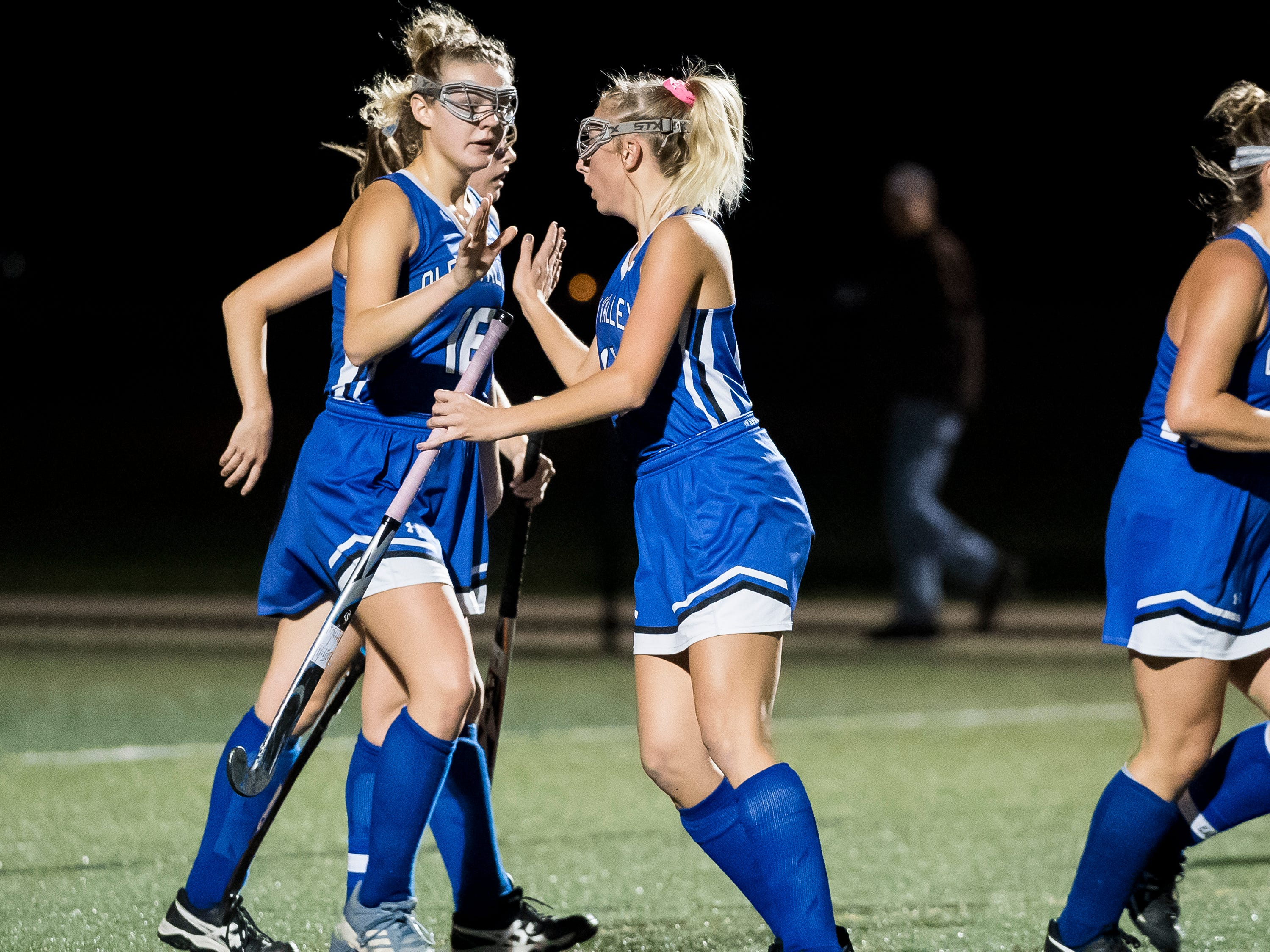 Oley Valley's Sarah Beers, left, and Madison Kline high-five after scoring a goal against Bermudian Springs during a District III Class A semifinal game at Lower Dauphin Middle School on Wednesday, October 31, 2018. The Eagles fell 5-0.