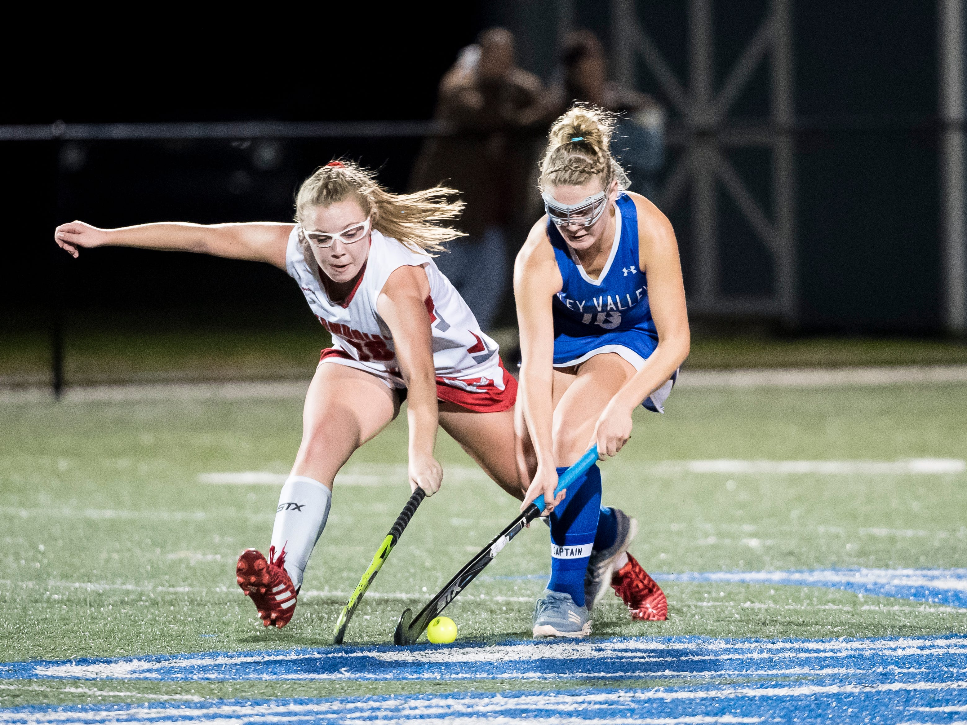 Bermudian Springs' Grace Metzger tries to take control of the ball from Oley Valley's Sarah Beers during a District III Class A semifinal game at Lower Dauphin Middle School on Wednesday, October 31, 2018. The Eagles fell 5-0.