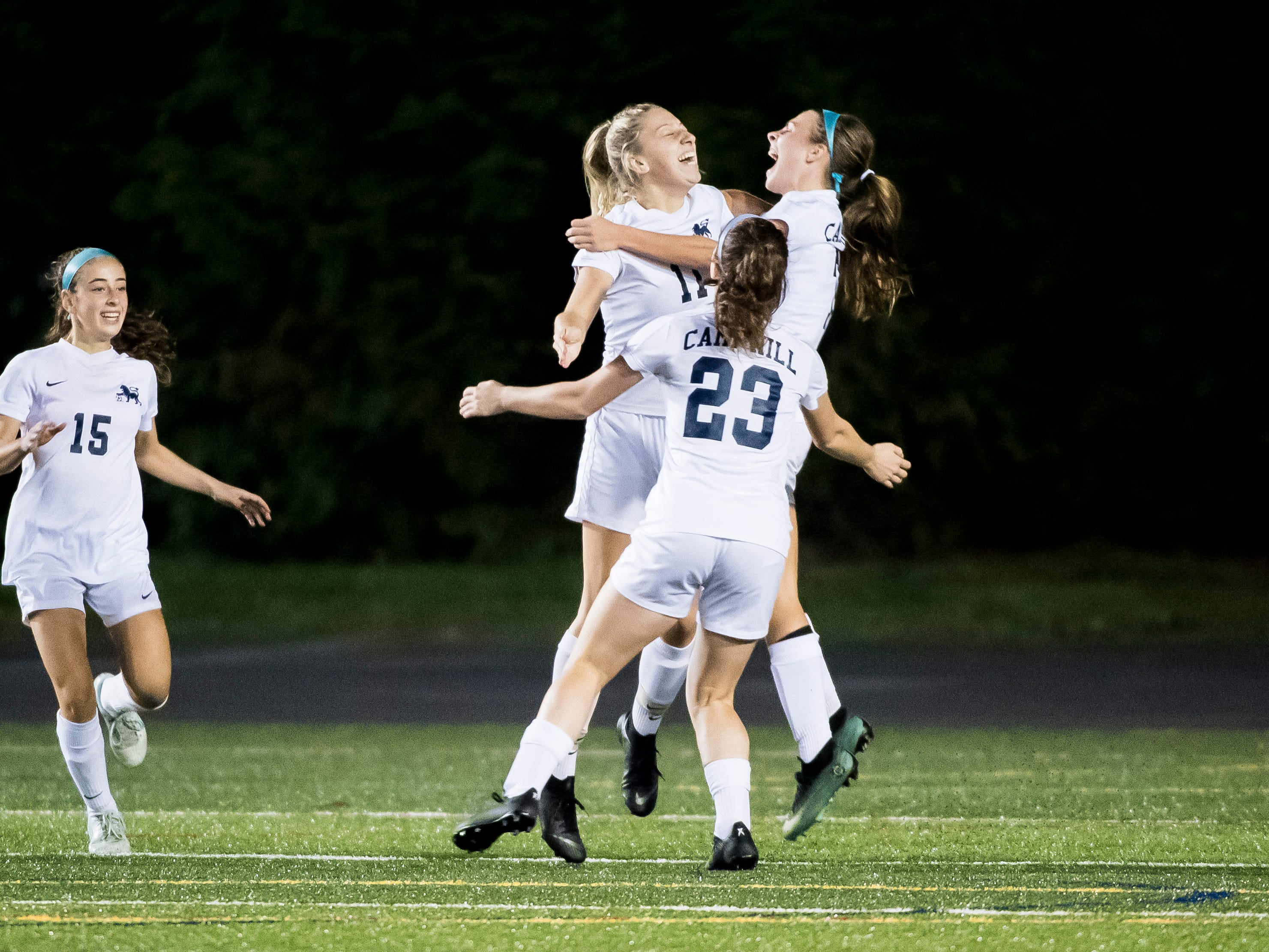Camp Hill players celebrate after scoring a goal in overtime during the PIAA District III Class A championship game at Hershey Park Stadium on Wednesday, October 31, 2018. The Knights fell 1-0.
