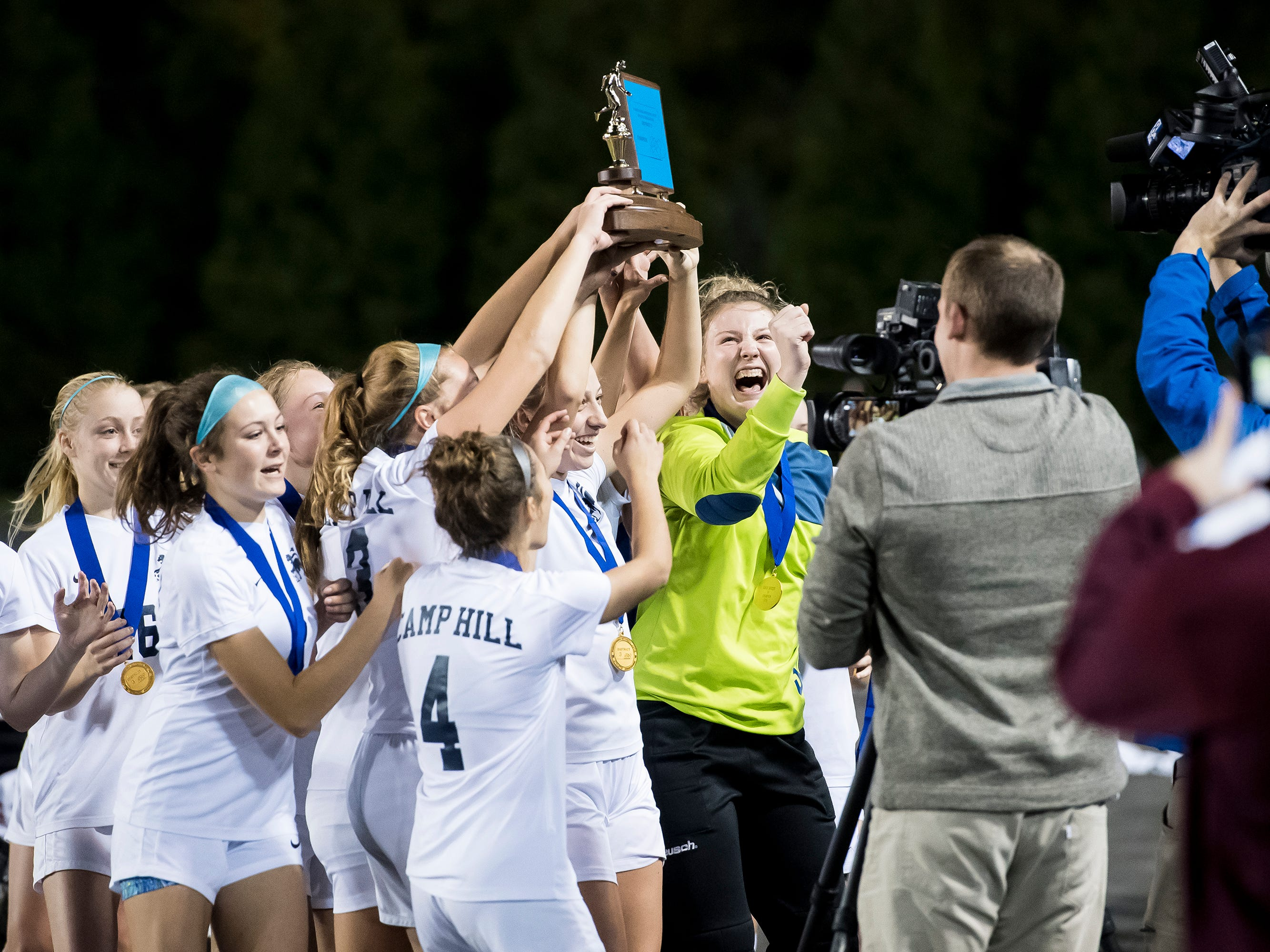 The Camp Hill Lions celebrate their PIAA District III Class A championship after defeating Fairfield 1-0 in overtime at Hershey Park Stadium on Wednesday, October 31, 2018.