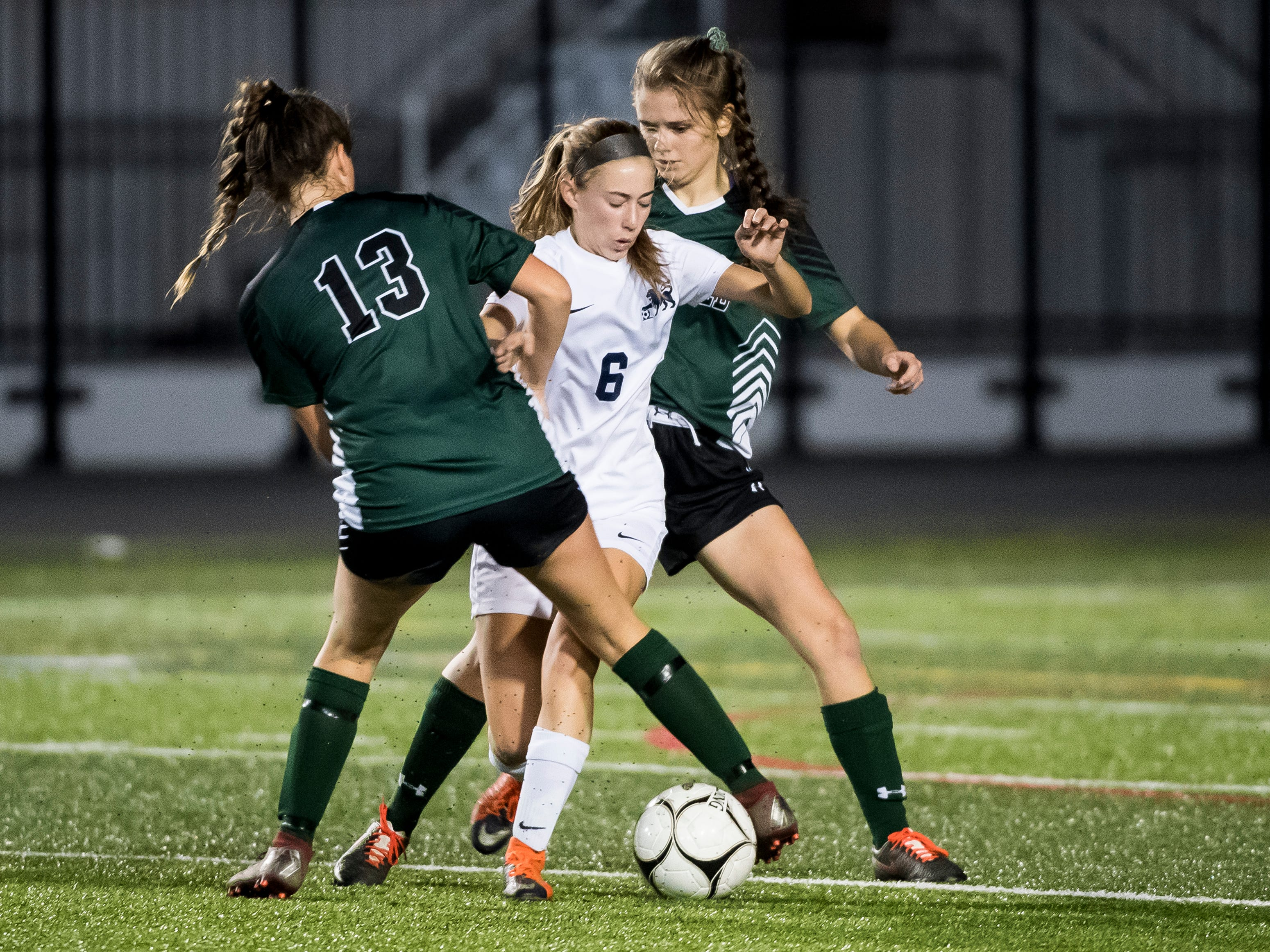 Camp Hill's Ava Brackett (6) gets trapped between Fairfield's Honey Strosnider (13) and Aliyah Hillman during the PIAA District III Class A championship game at Hershey Park Stadium on Wednesday, October 31, 2018. The Knights fell 1-0.