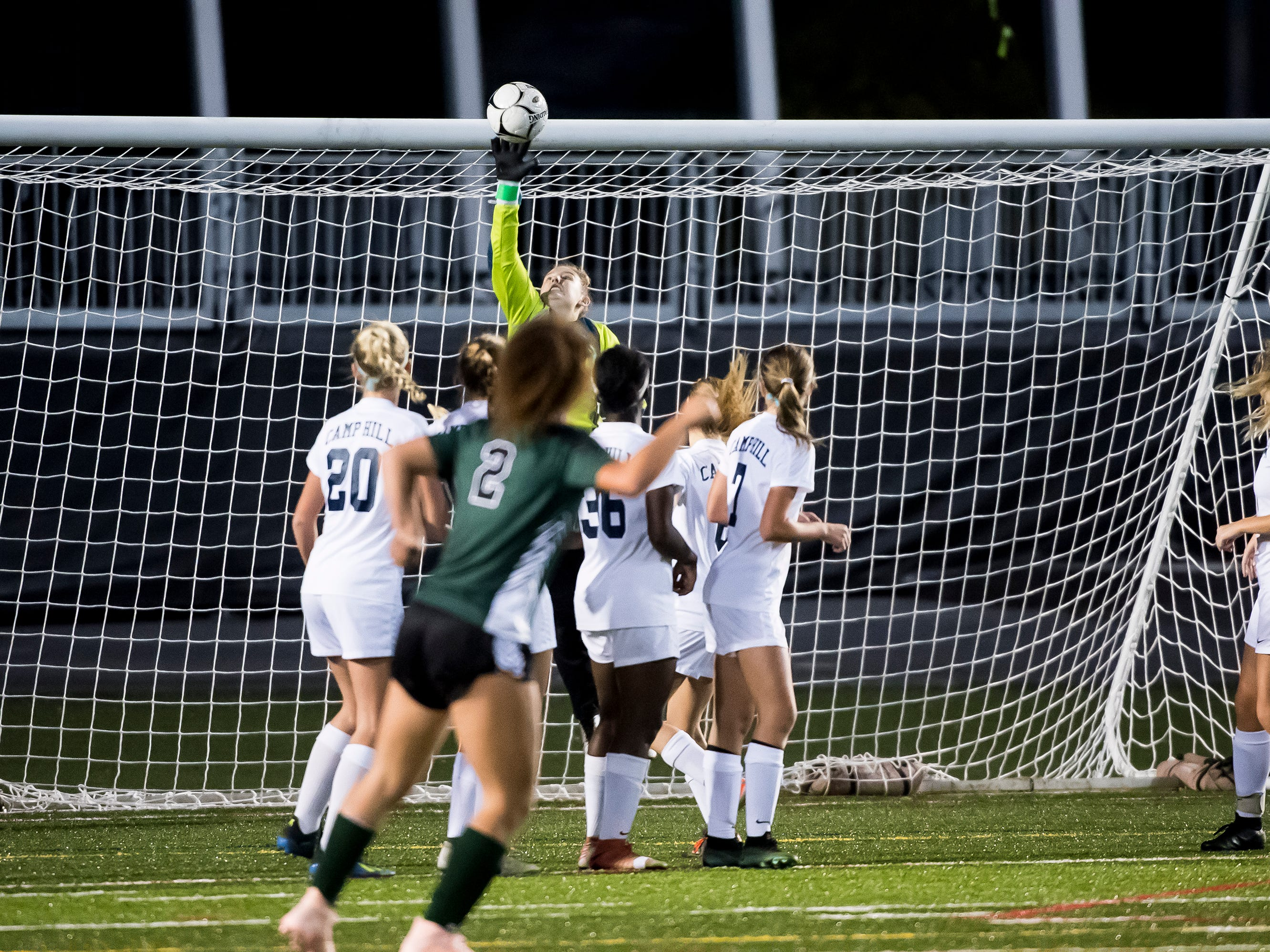 Camp Hill goal keeper Kendal McCall tips a direct free shot from Fairfield's Annabel Anderson out of play during the PIAA District III Class A championship game at Hershey Park Stadium on Wednesday, October 31, 2018. The Knights fell in overtime 1-0.
