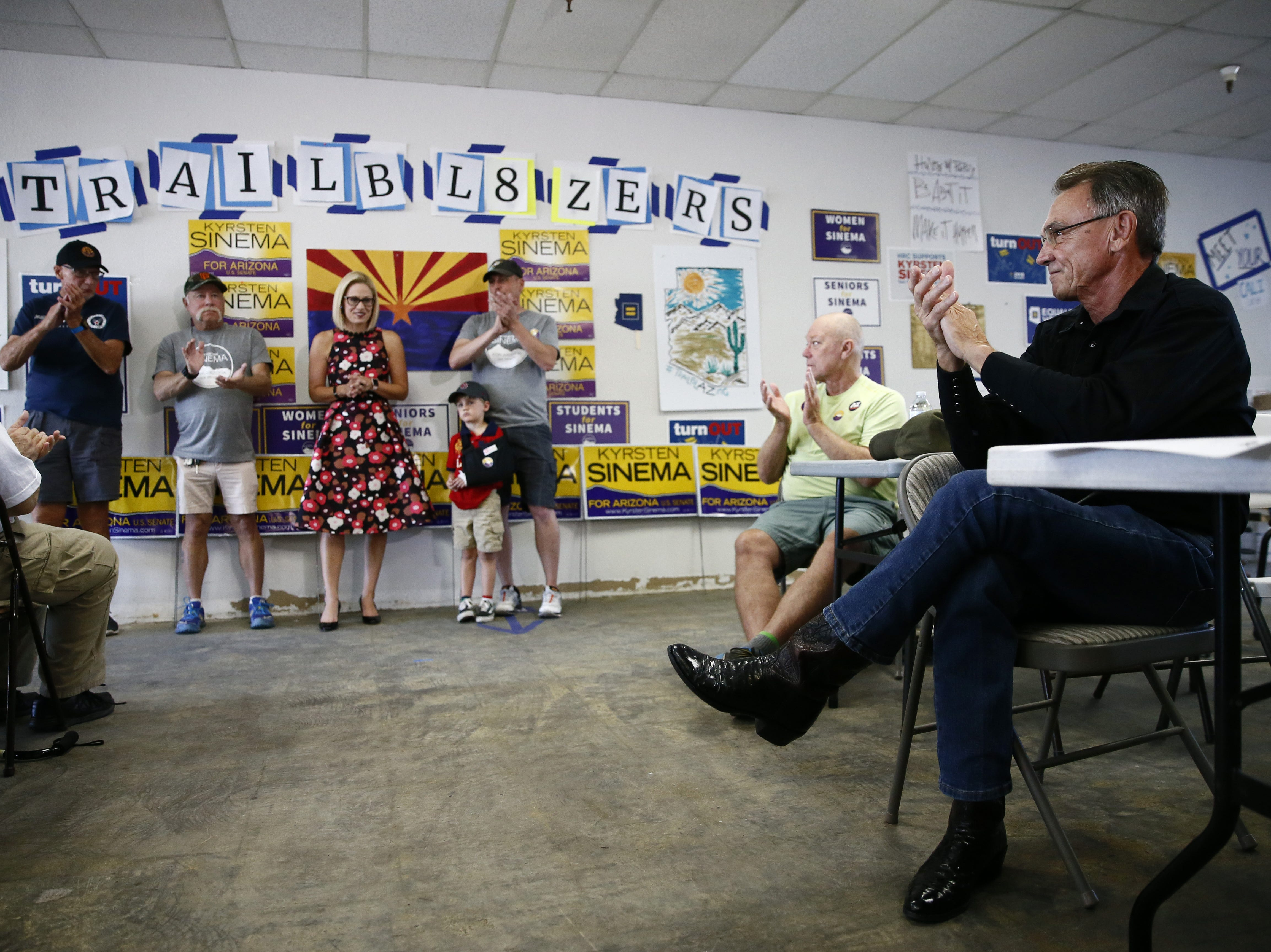 Kyrsten Sinema, the Democratic candidate for the U.S. Senate appears at a get-out-the-vote event with members of the Veterans for Sinema coalition and volunteers on Nov. 1 in Phoenix.