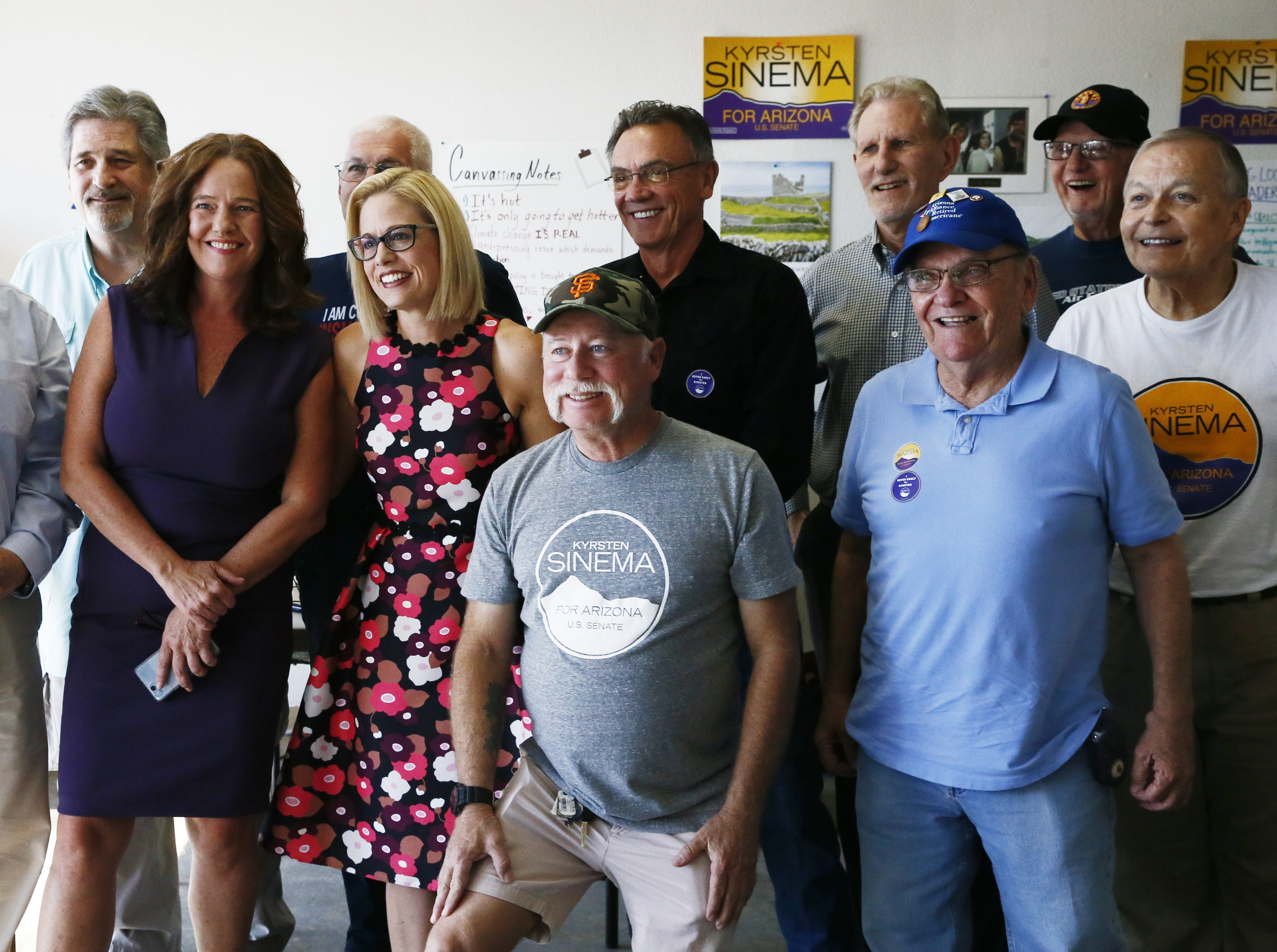 Kyrsten Sinema, the Democratic candidate for the U.S. Senate poses for a photograph at a get-out-the-vote event with members of the Veterans for Sinema coalition and volunteers on Nov. 1 in Phoenix.
