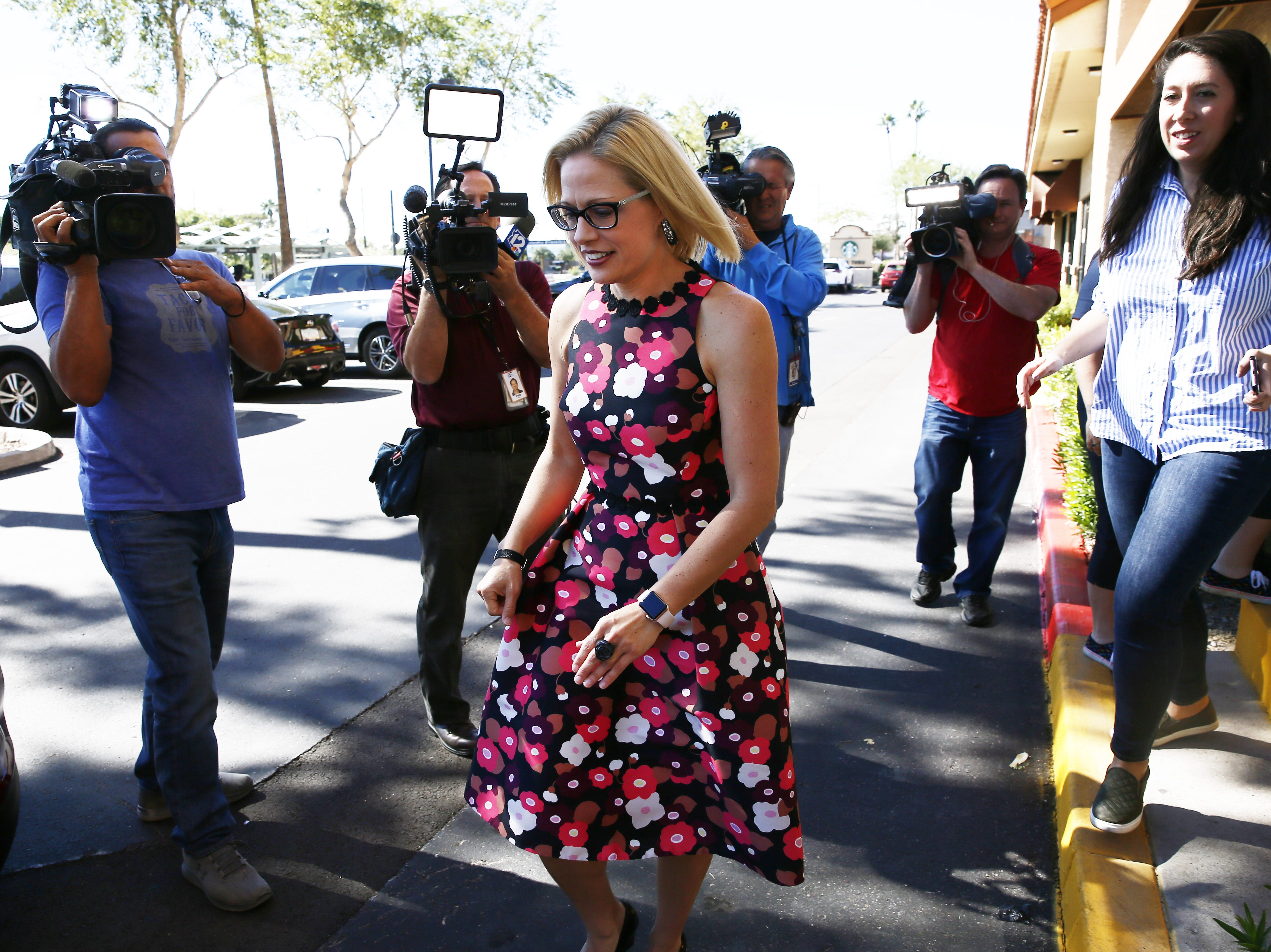 Kyrsten Sinema, the Democratic candidate for the U.S. Senate leaves her get-out-the-vote event with members of the Veterans for Sinema coalition and volunteers on Nov. 1 in Phoenix.