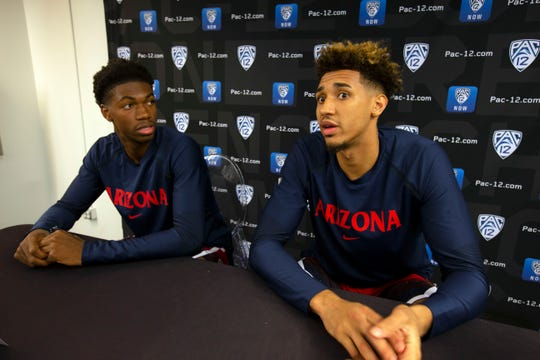 Wildcats players Brandon Randolph and Chase Jeter, right, speak to reporters during Pac-12 Media Day.