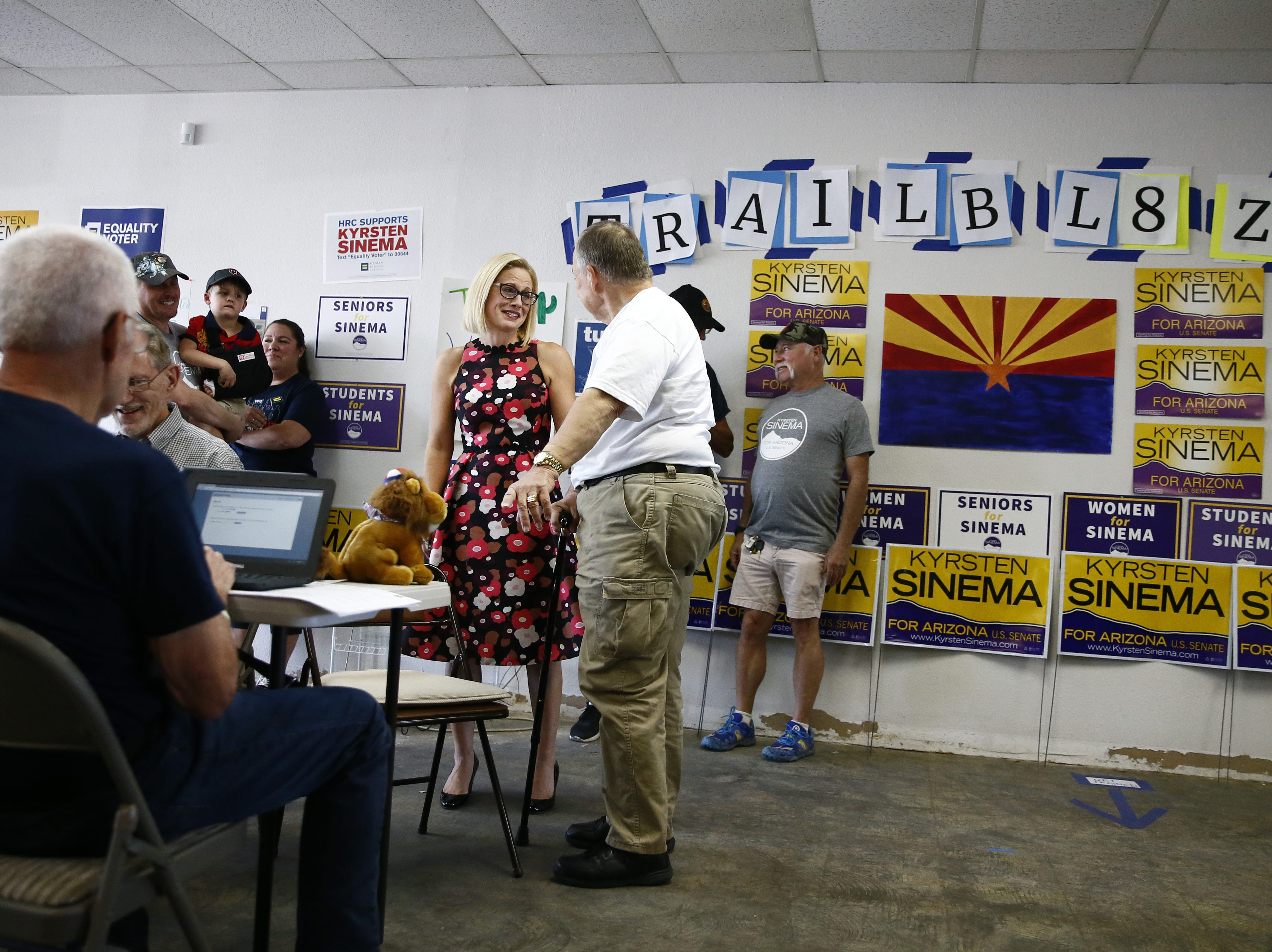 Kyrsten Sinema, the Democratic candidate for the U.S. Senate talks with veteran Leo Hintz of Laveen, Ariz. during a get-out-the-vote event with members of the Veterans for Sinema coalition and volunteers on Nov. 1 in Phoenix.