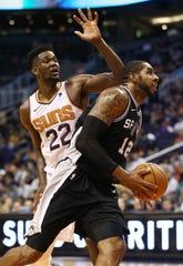 San Antonio Spurs forward LaMarcus Aldridge drives and score past Phoenix Suns' Deandre Ayton in the second half on Oct. 31 at Talking Stick Resort Arena.