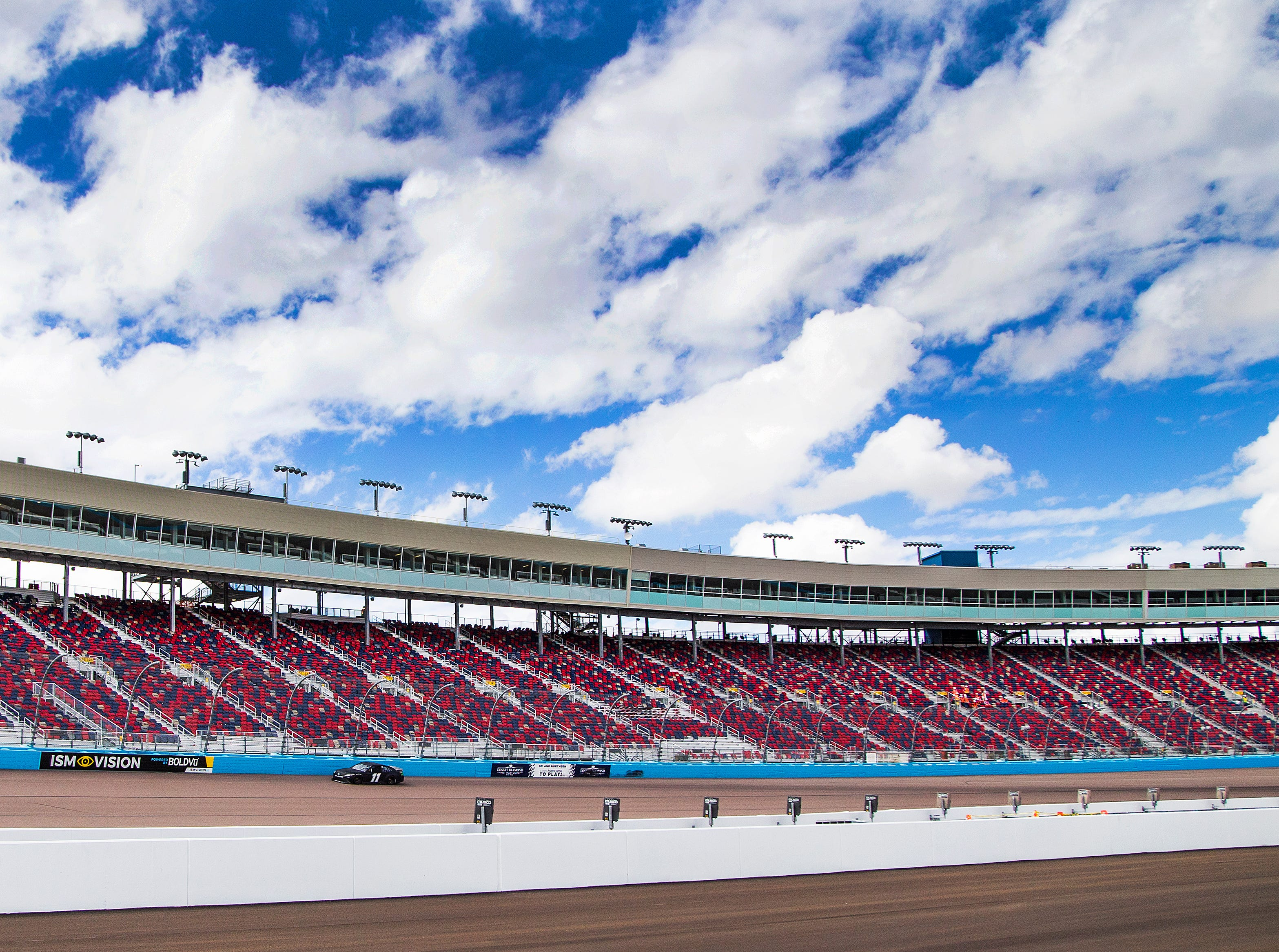 Denny Hamlin in the No. 11 car takes the new turn one during tire testing at ISM Raceway in Phoenix.  Final touches are being completed in the massive renovation of the former Phoenix International Raceway, Wednesday, October 3, 2018.
