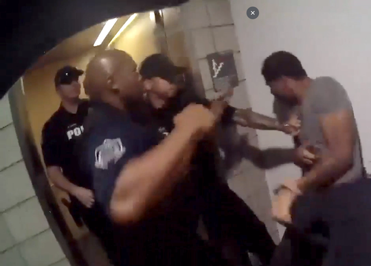 Mesa officers strike a man accused of disorderly conduct and hindering police in May 2018. The officers faced no discipline, and charges against Robert Johnson were dropped.