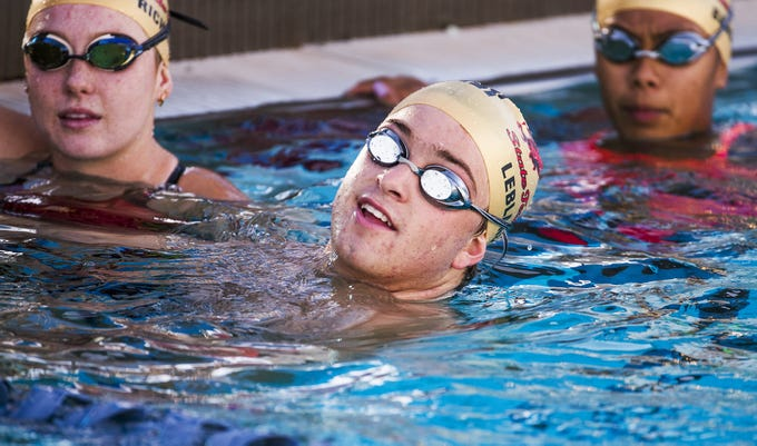 Chaparral High School swimmer Matthew Leblanc, middle, practices with the team at Cactus Aquatics and Fitness Center, Wednesday, October 31, 2018.