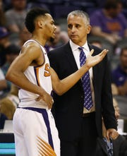 Suns rookie guard Elie Okobo talks with coach Igor Kokoskov during the second half of a game against the Spurs on Oct. 31 at Talking Stick Resort Arena.