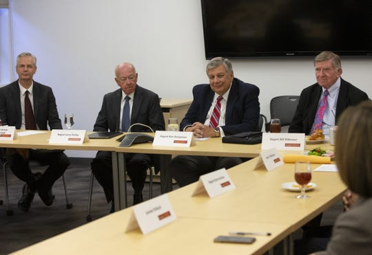The Arizona Board of Regents gathers to discuss the University of Arizona Men's Basketball Program with University of Arizona President Robert Robbins on Nov. 1, 2018. From left, Regents Executive Director John Arnold, Regent Larry Penley, Regents Chairman Ron Shoopman and Regent Bill Ridenour.