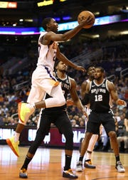 Suns forward Josh Jackson drives to the basket during the first half of a game against the Spurs on Oct. 31 at Talking Stick Resort Arena.