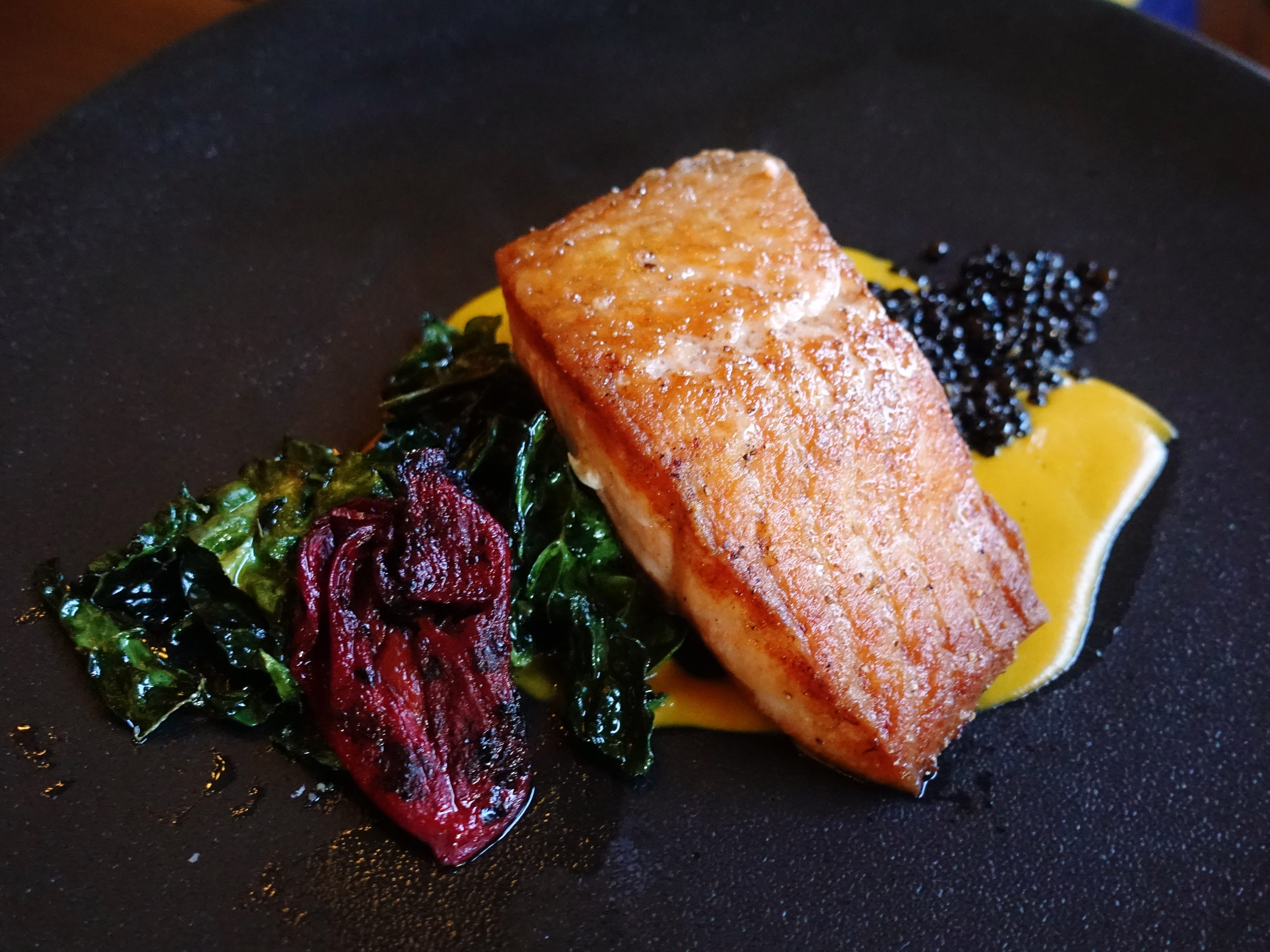 Salmon with black lentil, saffron-shrimp nage and Tuscan kale at Talavera at the Four Seasons in Scottsdale.