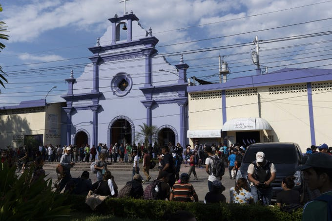 Mexican immigration officers have started allowing small groups of 50 to 200 Central American migrants, seen here Nov. 1, 2018, to cross the international bridge between Tecun Uman, Guatemala and Ciudad Hidalgo to give them the chance to apply to remain in the country as refugees.