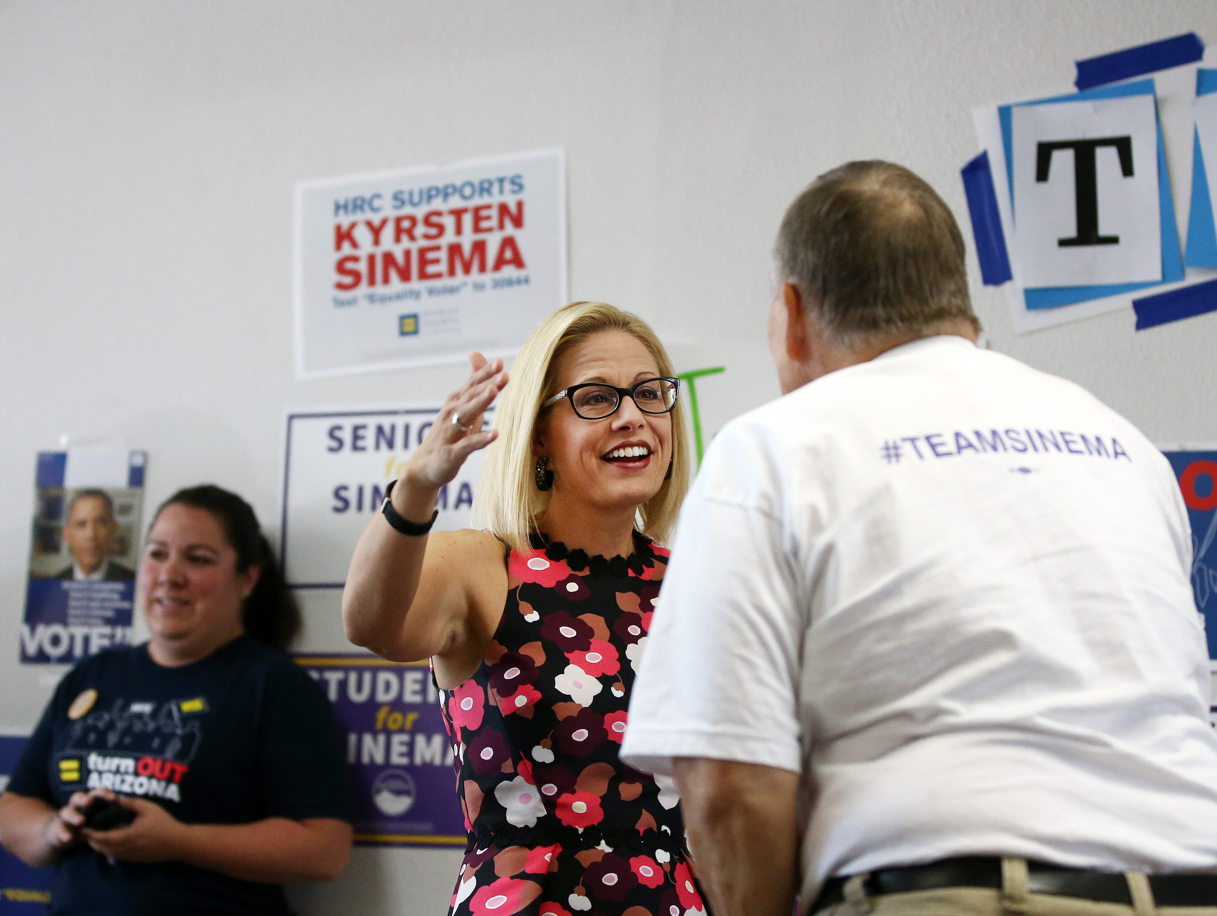 Kyrsten Sinema, the Democratic candidate for the U.S. Senate hugs veteran Leo Hintz of Laveen, Arizona, during a get-out-the-vote event with members of the Veterans for Sinema coalition and volunteers on Nov. 1 in Phoenix.