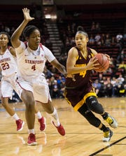 Kiara Russell drives to the basket against Stanford forward Nadia Fingall during a semifinal game of the Pac-12 Women's Basketball Tournament on March 3.