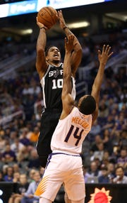 Spurs guard DeMar DeRozan shoots over Suns guard De'Anthony Melton during the second half of a game Oct. 31