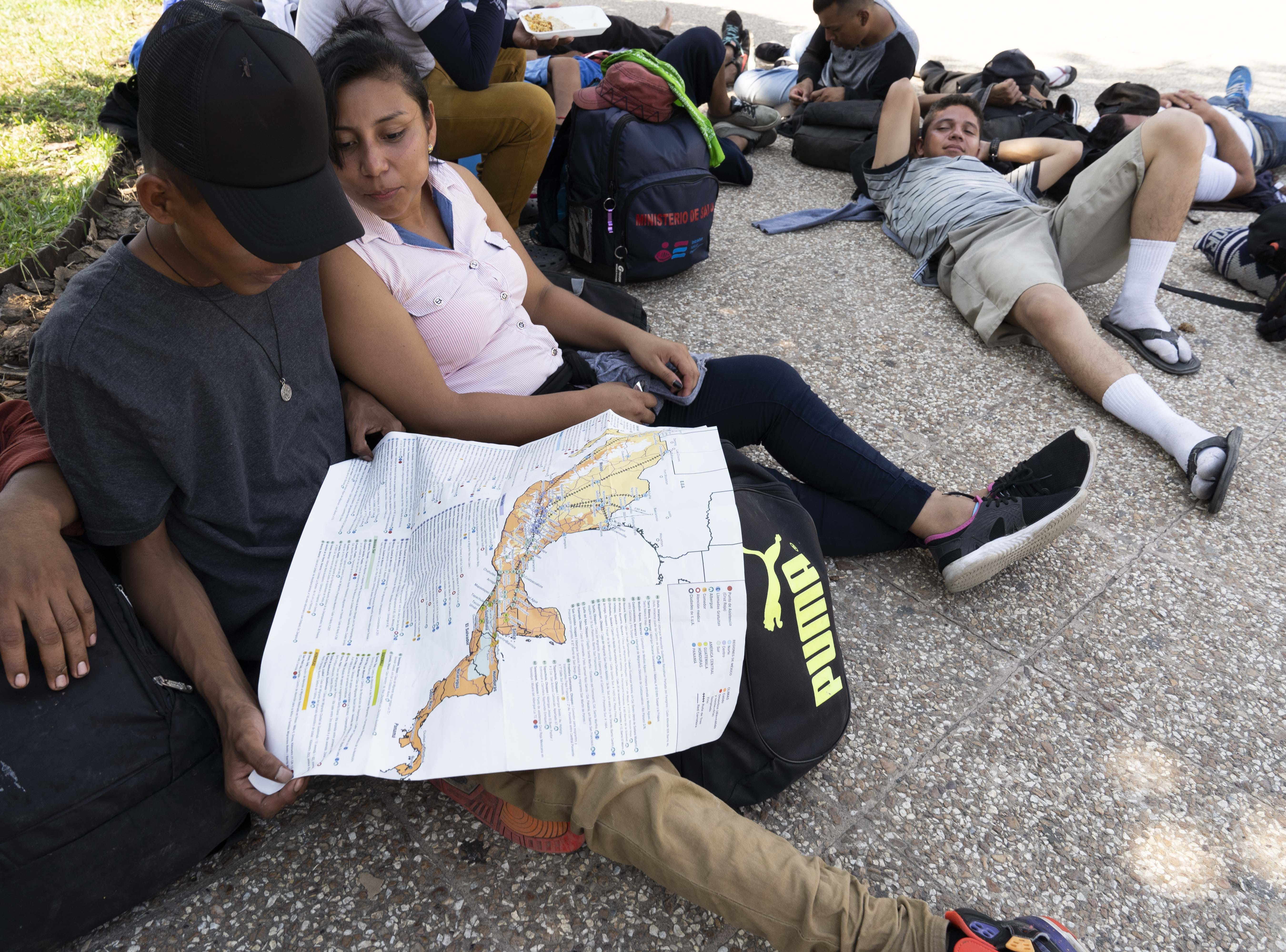 Kevin Vladimir of El Salvador joined another group of migrants preparing to cross into Mexico from Guatemala. He looks over the route map Nov. 1, 2018.