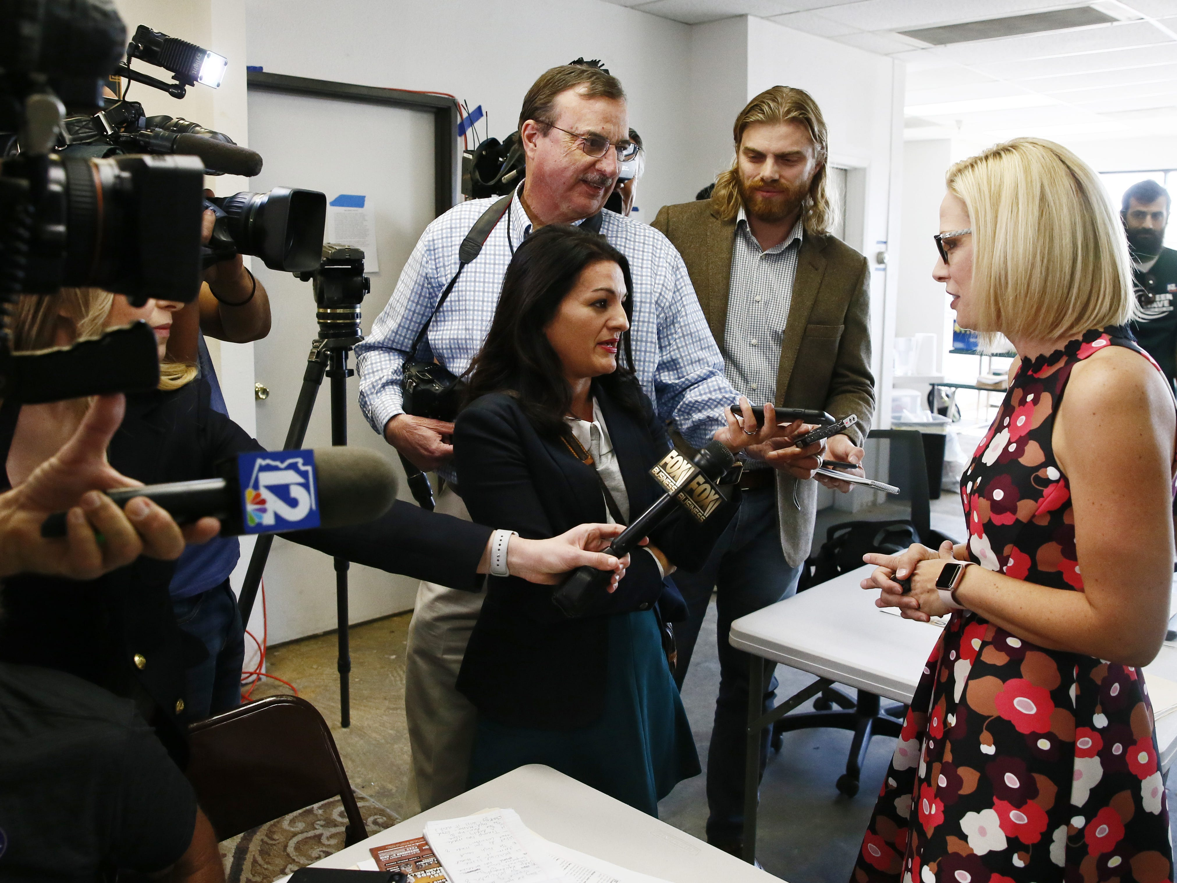 Kyrsten Sinema, the Democratic candidate for the U.S. Senate speaks to the press at a get-out-the-vote event with members of the Veterans for Sinema coalition and volunteers on Nov. 1 in Phoenix.