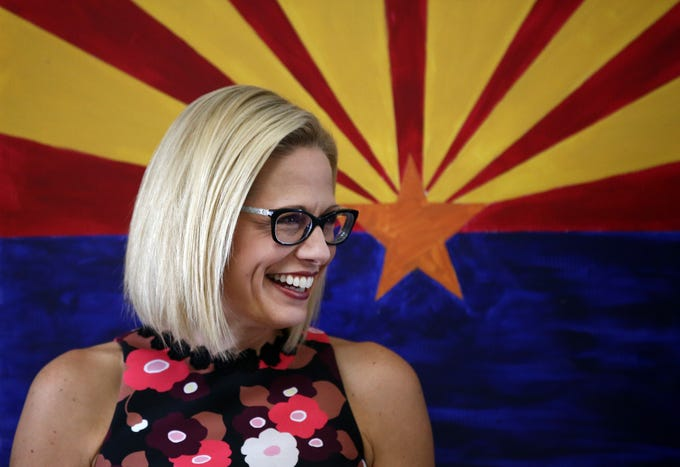 Kyrsten Sinema, the Democratic candidate for the U.S. Senate appears at get-out-the-vote event with members of the Veterans for Sinema coalition and volunteers on Nov. 1 in Phoenix.