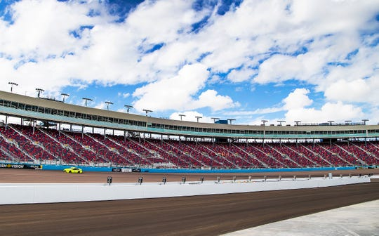 The new turn one and grandstands at ISM Raceway in Phoenix.  Final touches are being completed in the massive renovation of the former Phoenix International Raceway, Wednesday, October 3, 2018.