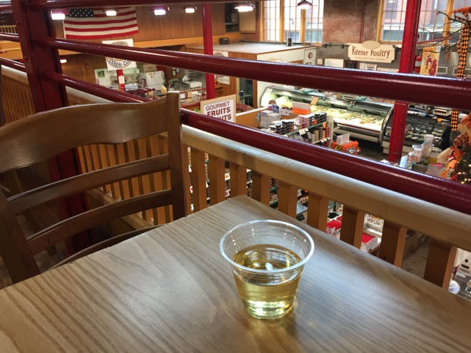 Grab a glass of wine and have a seat on the mezzanine overlooking the first floor of the Lebanon Farmers Market.
