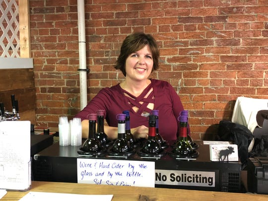 Jess Bouchette, who owns Bouchette Vineyards with her husband, Rick, is ready to serve a glass of wine at the Lebanon Farmers Market.