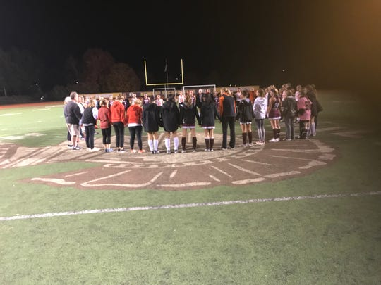 The Palmyra and Manheim Central field hockey teams joined together after the game for a prayer for the Warwick High School community that lost two students to a tragic car crash last week.