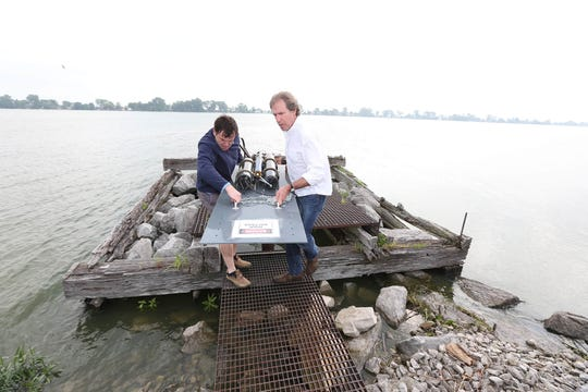 George Bullerjahn, director of the Lake Erie Center for Fresh Waters and Human Health, and BGSU algal bloom researcher Mike McKay work on sampling equipment.