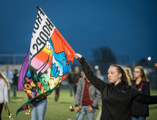 Marysville Viking Regiment color guard member Emily Koppel twirls a Fruity Hoops flag Thursday, Nov. 1, 2018 during practice at Marysville High School.