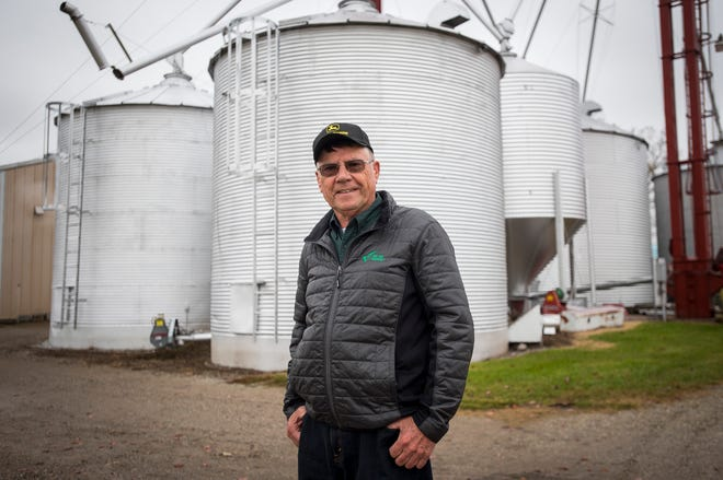 United Soybean Board director Jim Domagalski stands in front of several storage units full of soybeans on his farm Thursday, Nov. 1, 2018 in Columbus.
