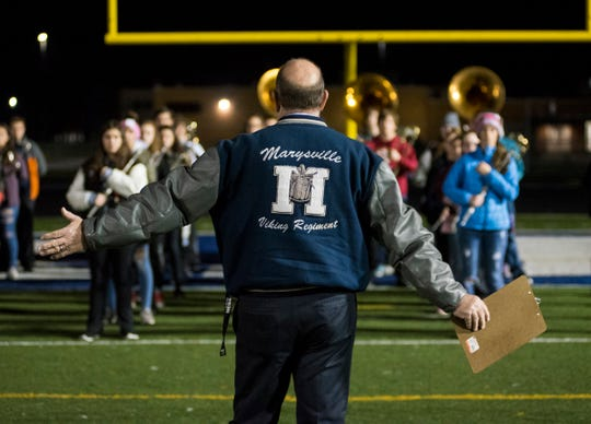 Marysville Director of Bands Dennis Duso talks to the Viking Regiment before they take the field for a run through during practice Thursday, Nov. 1, 2018 at Marysville High School.