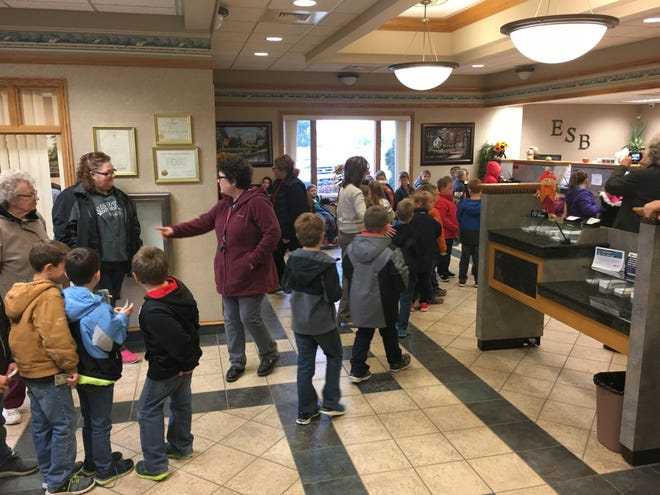 Sandusky Elementary School students line up to make a deposit at Exchange State Bank as part of a county-wide Deposit Day activity on Oct. 30, 2018.