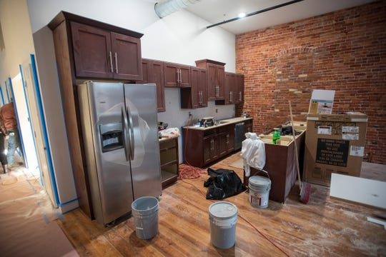 Construction on a kitchen in a loft in the Ballentine building. Residents are beginning to move into the completed units.