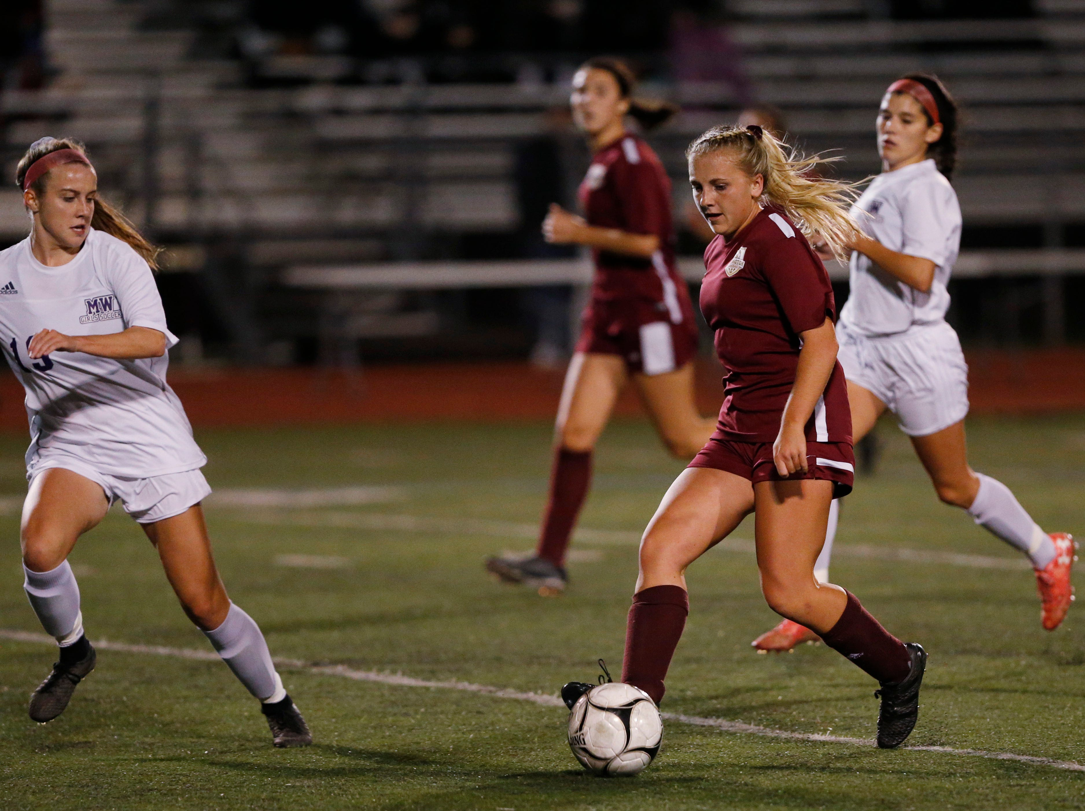 Arlington's Molly Feighan moves the ball up field against Monroe-Woodbury during the Class AA regional semifinal.