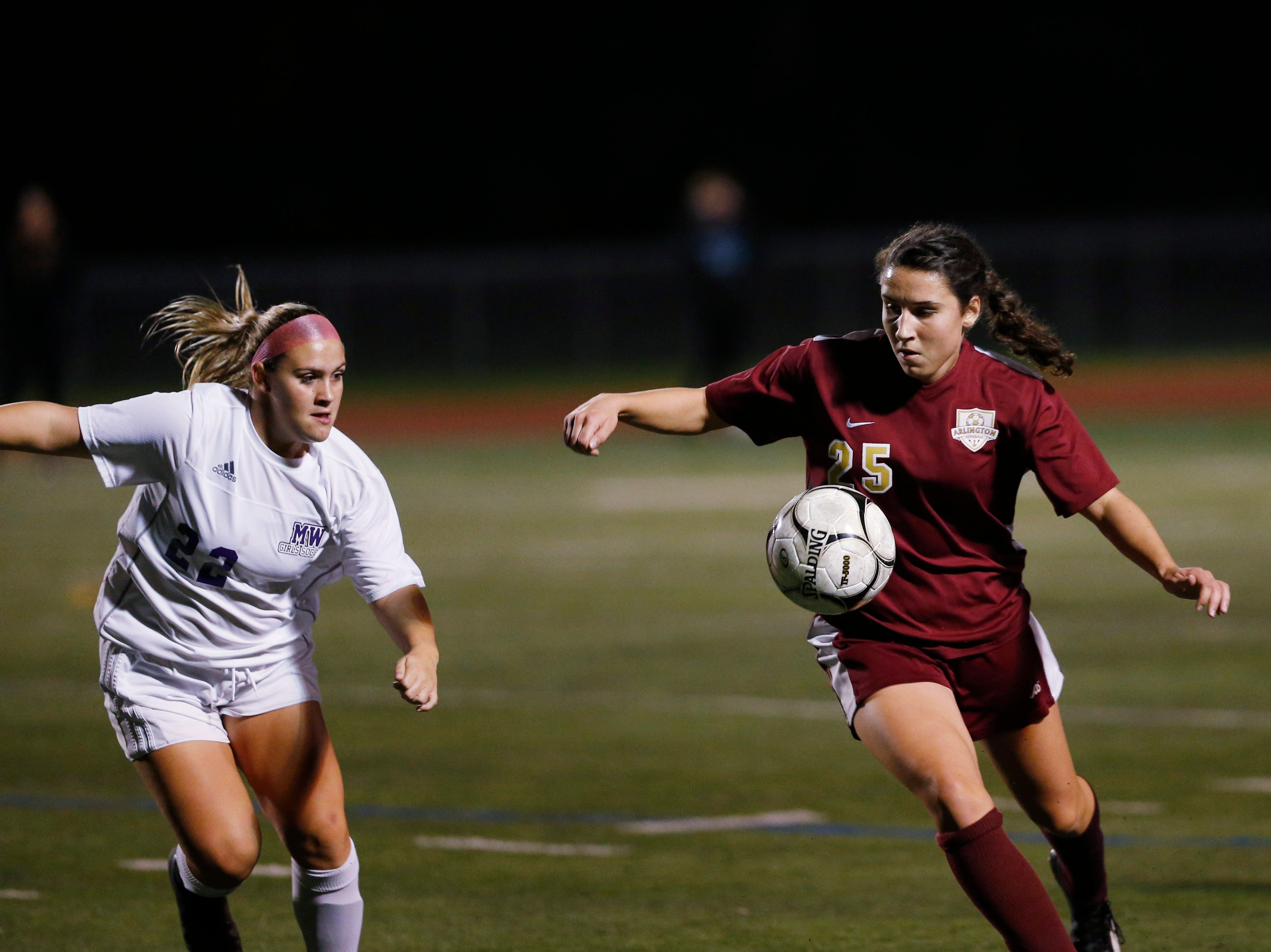 Arlington's Kelly Koster traps the ball as Monroe-Woodbury's Kayla Bauer closes in on her during Wednesday's class AA regional semifinal in Freedom Plains on October 31, 2018.