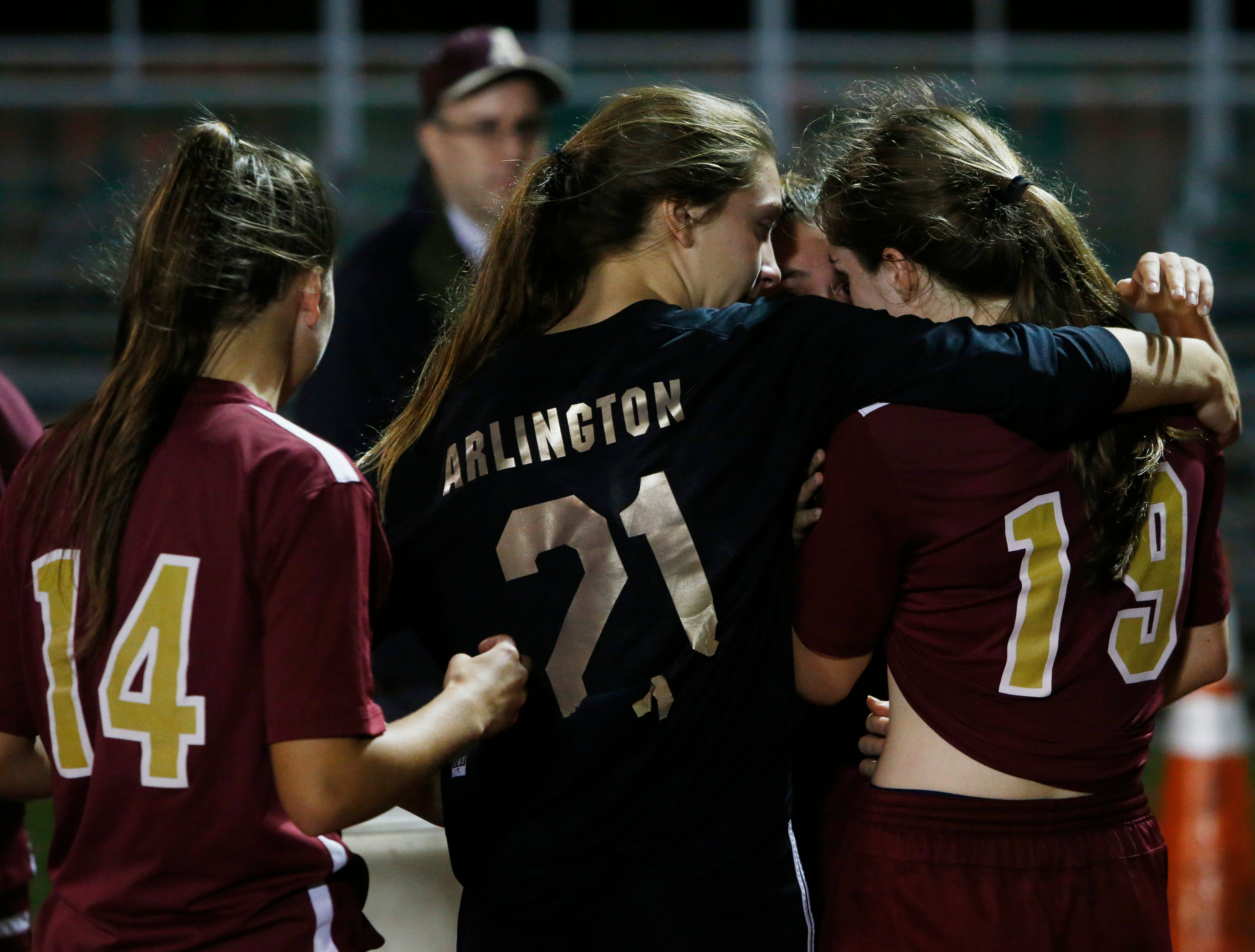 Arlington's girls soccer team console each other after falling to Monroe-Woodbury in Wednesday's class AA regional semifinal in Freedom Plains on October 31, 2018.