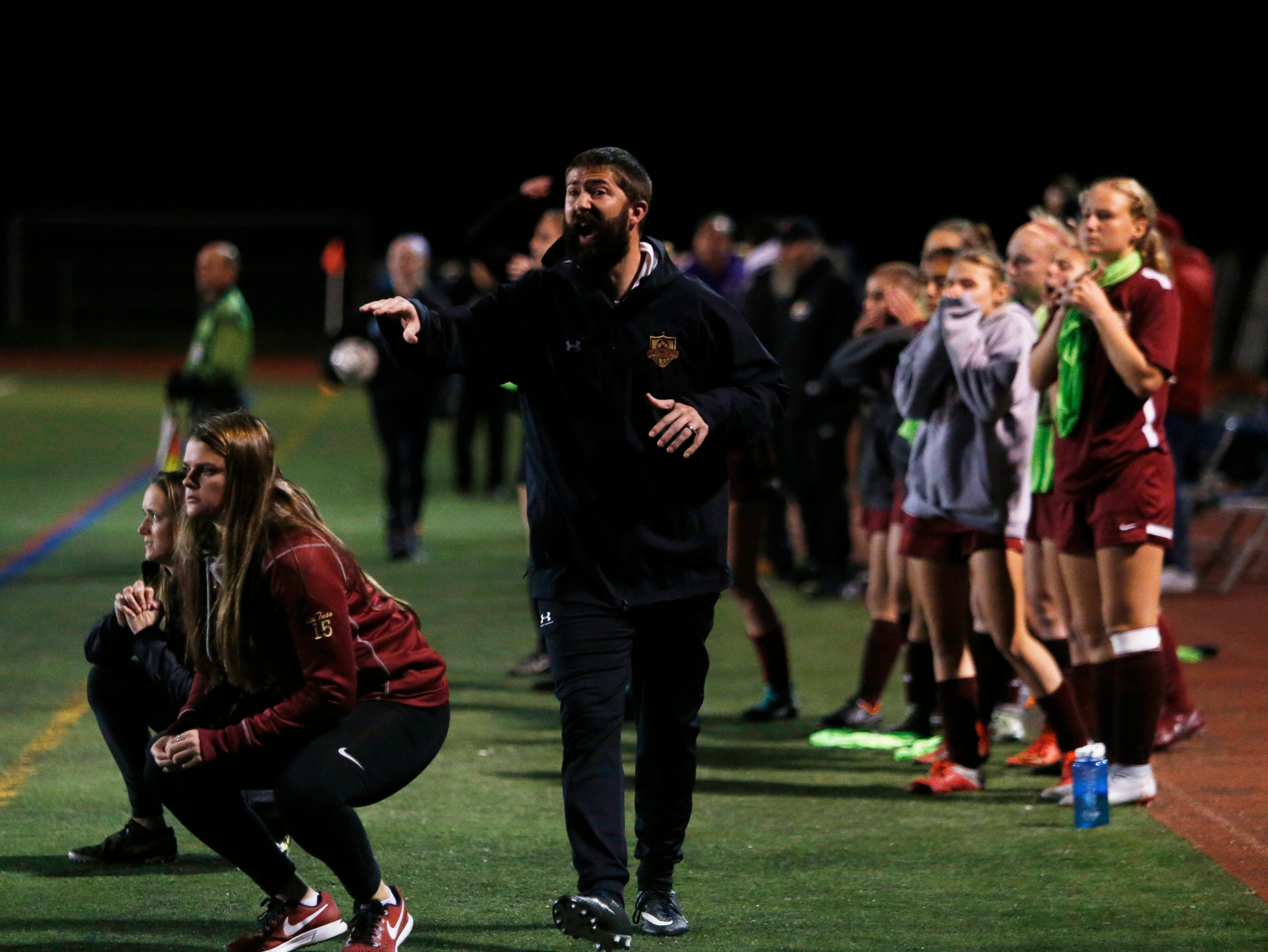 Arlington's assistant coach Jason Conklin shouts instructions to his players during Wednesday's class AA regional semifinal versus Monroe-Woodbury in Freedom Plains on October 31, 2018.
