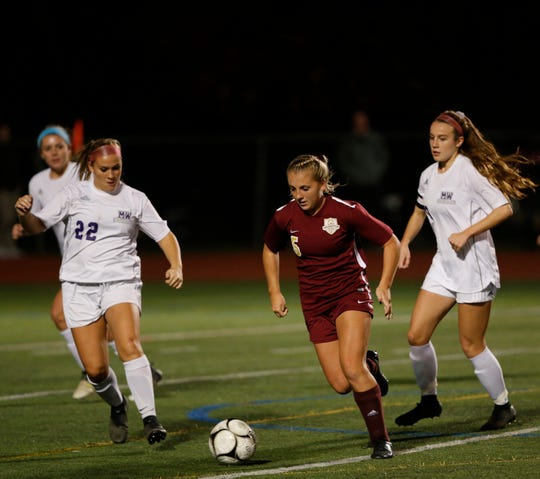 Arlington's Kendall Feighan moves the ball up field against Monroe-Woodbury during the Class AA regional final.