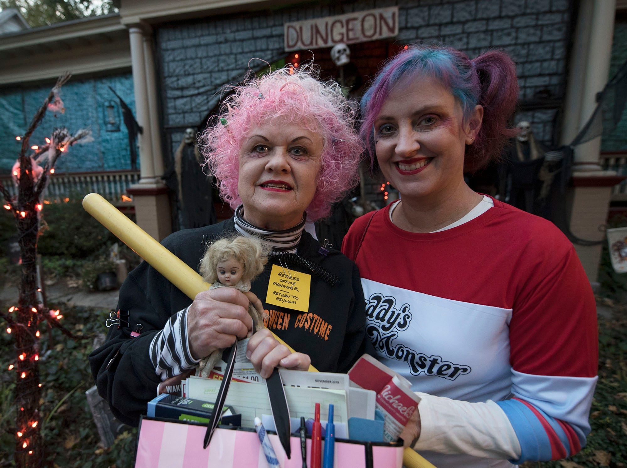 Maggie O'Sullivan, left, and Heather Cooper wear their Halloween costumes. Bob and Sarah Prince hosted their annual Halloween Haunted House at 47 Fifth Avenue, Chambersburg, do the delight of trick-or-treaters.