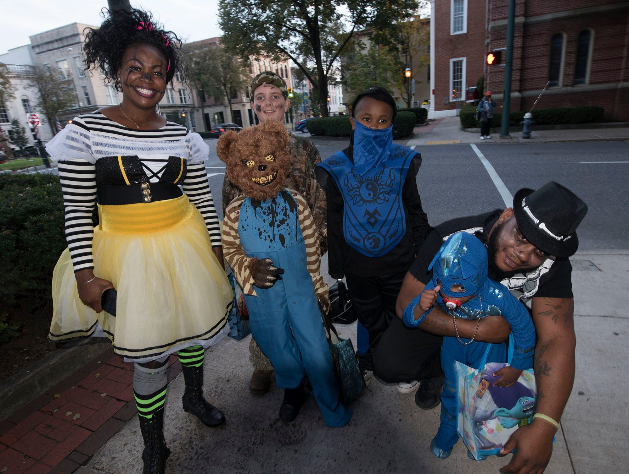 Vincent and LaAngel King are in costumes with their kids and neighbors in downtown Chambersburg on trick or treat night, Oct. 31, 2018.