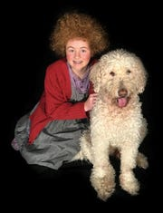 "McKenna Spangler stars in ""Annie"" at the Belmont Theatre, featuring Melvin as Sandy."