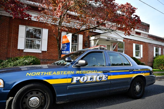 A Northeastern Regional Police car is parked in front of the vacant New York Wire building at 152 N. Main St. in Mount Wolf, Thursday, Nov. 1, 2018. Dawn J. Sagert photo
